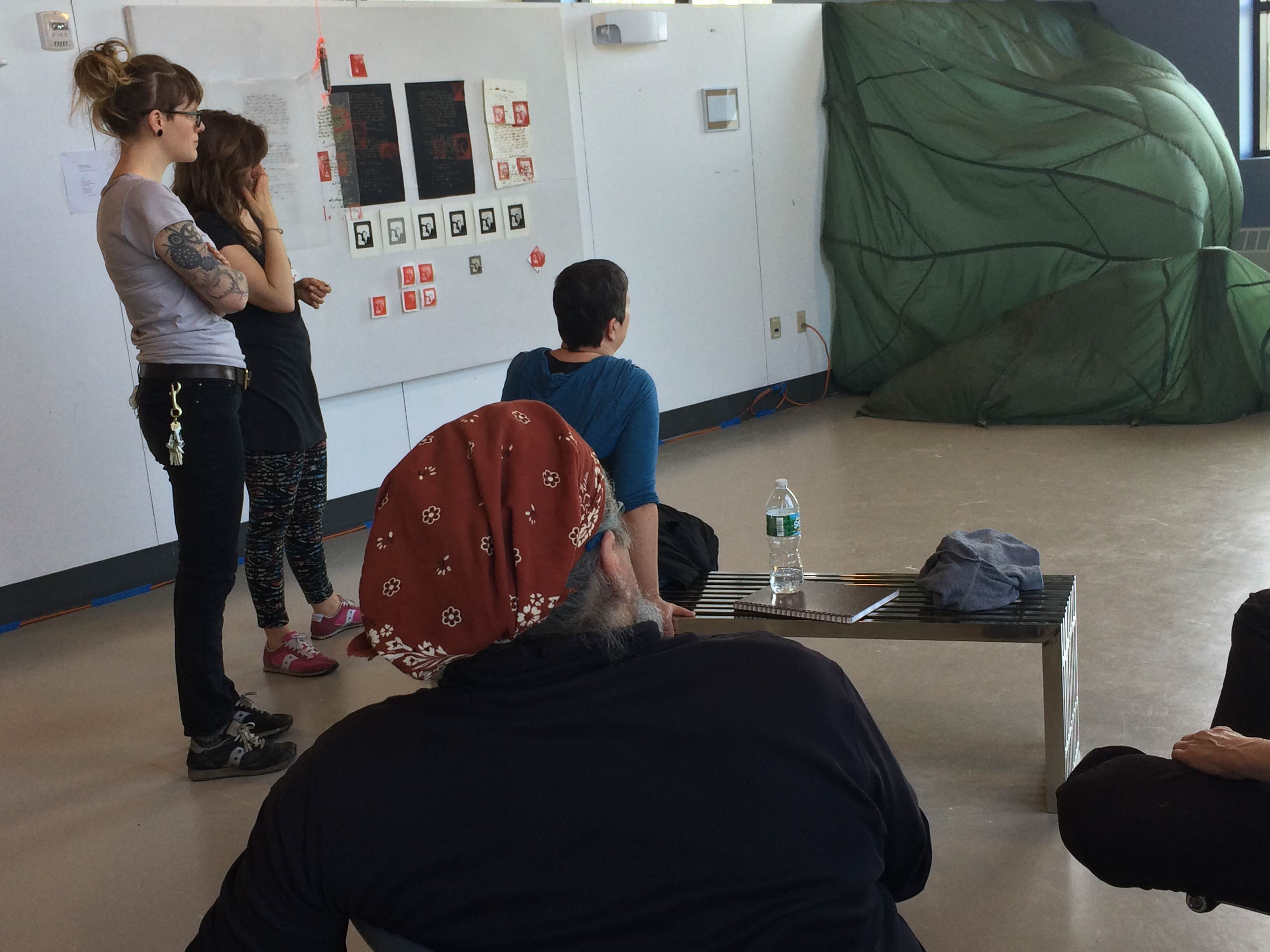 MFA students discussion work in a studio critique.