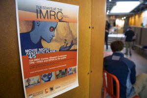 View of IMRC Center Commons space with poster for movie night event.