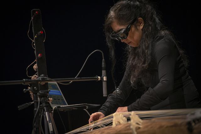 Miya Masaoka performing on her digitally augmented Koto