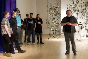MFA Director speaks to faculty and students at the 2018 Thesis exhibition.