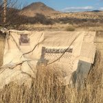 Image os textle piece Mourning Cloth tied to barbed wire fense ins Texas