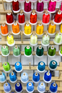Photo of colored bobbins from Textle lab