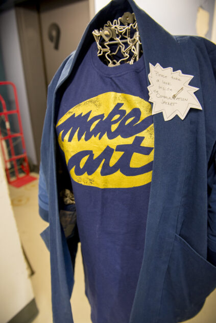 """photograph of art installation or a T-shirt with the slogan """"Make Art"""" on it."""